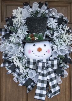 Who wouldn't love this black and white plaid snowman wreath? This adorable snowman wreath is made on Christmas Mesh Wreaths, Christmas Swags, Christmas Crafts, Christmas Ornaments, Winter Wreaths, Christmas Christmas, Snowman Christmas Decorations, Burlap Christmas, Spring Wreaths