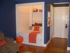 Put your bed in a closet. The white of the walls blends right into the white of the linens, making the space feel bigger and brighter. I love the pops of orange she's got going on -- especially that garden urn turned magazine rack!
