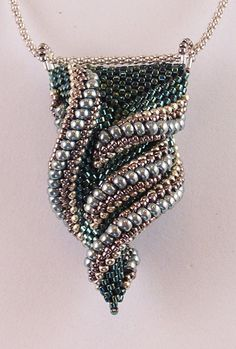 Description: This design will intrigue you with its asymmetrical curves that twist into a miniature tornado. Students will learn the surprising technique used to create this piece and see many variations. Who knows where the twists and turns will take you? We will also explore some of the possible variations that can be achieved. Students should be proficient in peyote stitch and be comfortable with three-dimensional work