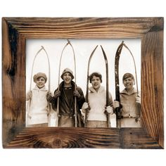 Girls with Old Skis Framed Print