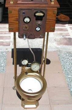 "A steampunk toilet, created by Patrick Brawley — the ""antique toilet of the future."" Awesome! It boasts a control panel and laser pointing mechanism."