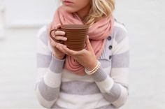 Grey Striped sweater with Pink scarf.