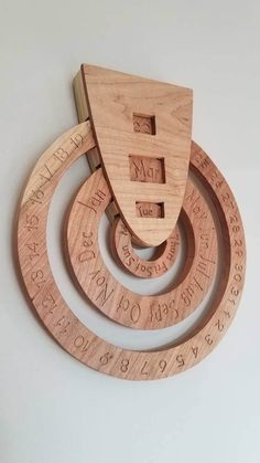 This listing is for 1 wooden perpetual calendar. We always put a calendar for the current month in an area that the kids are able to see the date. My son has learned a little more about recycling and he asked about the calendar and recycling. We wanted to make something that fit our style and was still easy for the kids to use and this is what we came up with! A circular spinning perpetual calendar. This hangs from the wall like a picture would on a nail or a screw. The rings turn manually…