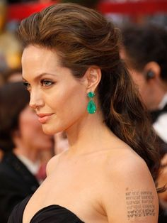 Angelina Jolie, 2009 This gorgeous half-up look almost garnered more attention than her famous red-carpet lip-lock. Almost. The swept-back waves showcased the $2.5 million in emeralds dripping from her ears.
