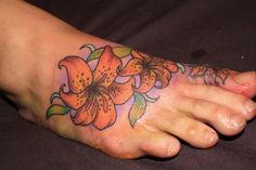 Lily tattoo on foot..LOVE HOW IT GOES ALL THE WAY UP TO TE TOE!!