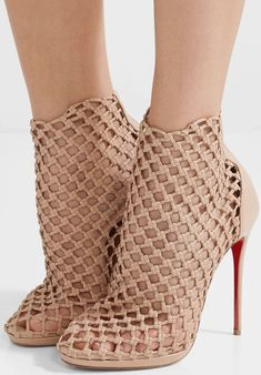 Christian Louboutin's 'Porligat' boots are woven from strips of leather - each is knotted to create a fishnet effect. Designed to sit just below the ankle, they're set on a vertiginous heel and turn to reveal the house's signature red lacquered sole. Christian Louboutin, Christian Dior, Sexy Heels, Stiletto Heels, Pumps, Hot Shoes, Shoes Heels, Heels Outfits, Bootie Boots