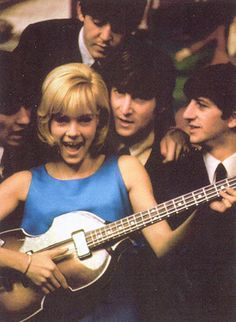 Yeah yeah yeah... she obviously can't play.. they obviously don't care.... (a left handed Hofner, no less).
