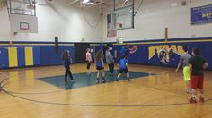 Grabbing a rebound in basketball, we are going full court in gym class. #byrampride