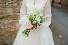 White and green meadow style bouquet with Rosemary | Photography by http://jesspetrie.com/