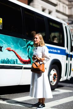 NYFW   Street Style Trend Alert: Skirts and Sneakers Feminine frocks and sporty sneakers are a thing at this year's coveted New York Fashion Week. Check out some of our favorite looks from the week and get inspired to take this playful trend from the jungle gym to the urban jungle. Kate Foley - Photographed by Nabile Quenum for New York Magazine