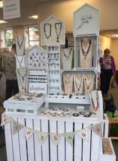 Good use of height for a craft fair jewelry display.