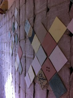 Old wall with diamond shaped pastel colored tex-tiles #diamonshape #diamond #triangle #tiles #pastel #design #bathroom #textiles #transparant #white #translucent #porcelain #textiles #wall #decoration #led #imprint #relief #barbaravos #wallcovering #kitchen #shower #home #interior #design #glaze #backsplash #flower #pattern #coral #fabric #lace #texture