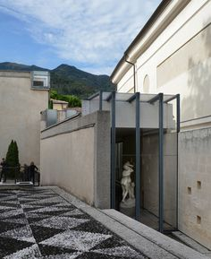 https://flic.kr/p/eMSRwg | carlo scarpa, architect: gipsoteca del canova, extension of the canova museum in possagno, italy 1955-1957. view from the south. | gipsoteca del canova, canova plaster cast gallery extension, possagno 1955-57. architect: carlo scarpa 1906-1978 with v. pastor.  view from the south.  to the right is the original, 19th century museum. the rooms of scarpa's extension are articulated almost as individual buildings and follow the the outline of earlier houses on the…