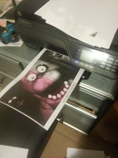 "So i hear my printer starting up from nowhere (i was in the other room) and it takes 10 minutes to print fully after a few minutes my curiosity is peaked as to what or who was printing anything. We have one of those wireless printers you can e-mail too and staring me in the face is this: Now i'm a rational person so i checked my print history online and there is no record of this ever being sent to the printer. Nothing at all.The text at the bottom reads.  ""WE'RE ...COMING"""