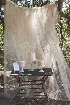 Take the cakes away once you've cut it and have this spot as a backdrop for a 'photo booth style area, paint some picture frames and have a bucket of props to go with it. You get some great pics