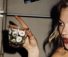 vintage kate moss & glass of flowers