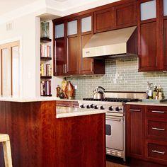 Warm wood contrasts beautifully with the light green tiled backsplash. More stylish pairings here: http://www.bhg.com/kitchen/backsplash/backsplash-pairings/?socsrc=bhgpin061314warmandtraditional&page=9