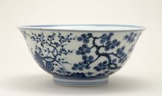 Deep porcelain bowl. Underglaze blue with the Three Friends of Winter in a landscape. Central roundel inside with similar Three Friends and rock motif. There is an inscription on the base. Ming Dynasty