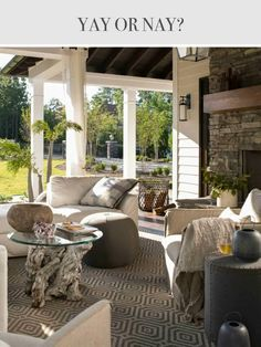 Gorgeous patio, driftwood table and outdoor rug.