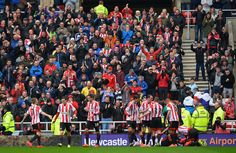 Sunderland players and fans celebrate the opening goal scored by Connor Wickham during the Barclays Premier League match between Sunderland ...