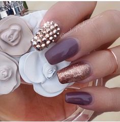 Beautiful rose gold and deep purple nails with gold rhinestones. A fall must have.