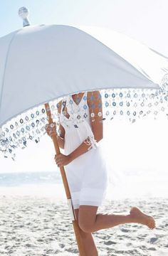 Here comes Cass with a huge glittery umbrella for Ms. glam.............Darling texted and he's just found a valet parking spot.