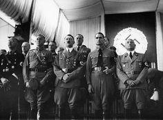 Himmler, Lutze, Hitler, Hess and Streicher. The second row includes von Ribbentrop, Brueckner and Schaub. 1935.