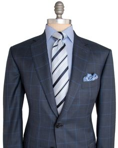 """Brioni Navy and Blue Plaid Suit 2 button jacket Notch lapel Blue melton Front left chest pocket Flap pockets Fully lined Light blue lining Double vent Flat front pant  Zip fly 2 button with hook and bar closure Double welt button back pockets 11"""" rise 8"""" hem opening   85% wool, 15% silk Made in Italy"""