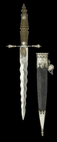 Pinning this because I like the scabbard, not the dagger itself. haha.  Spanish Colonial Dagger.      Dated: late 18th century.