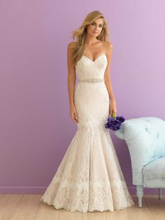 Allure Romance 2916. This strapless piece is adorned with delicate lace applique on English net.
