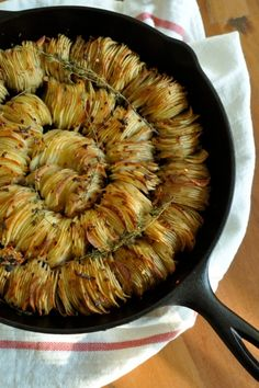 CRISPY POTATO ROAST    Gather:  3 tablespoons butter, melted  3 tablespoons olive oil  4 pounds potatoes, peeled  4 shallots, thinly sliced  1 teaspoon salt  1 teaspoon crushed red pepper  a pinch paprika  a few springs of thyme, and    a mandoline or a sharp knife