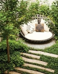 Love the steps leading down. That round seat just invites lounging around.