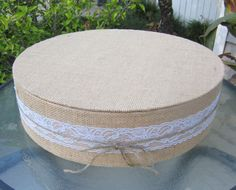 Burlap and Lace Wedding Cake Stand tied with a bow. ClassyCakeStands $25 for 8 inch stand. Switch twine for royal blue ribbon.