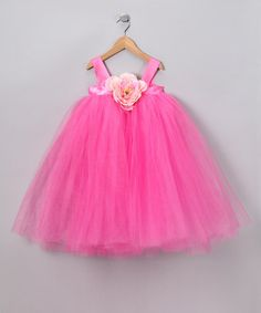 Take a look at this Hot Pink Flora Dress - Infant, Toddler & Girls by Heart to Heart on #zulily today!    Going to hav to make this when my mom gets to town in May so she can help me sew this! Super cute and there is version in a Light Pink! Will make one for each girl.