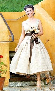 Classy! Pin up style.  I love this style of dress for a wedding, when I redo my vows, but with a red or purple bow.