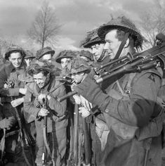 1 December 1944: 'Dead tired' on the front line in Holland. Troops of the 1st Norfolk Regiment during the advance on Wanssum, Holland, 26 November 1944.