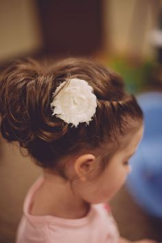 flower girl hair updo, braided twist into an upside down ponytail with a little fabric flower. such a cute miniature bridesmaid!
