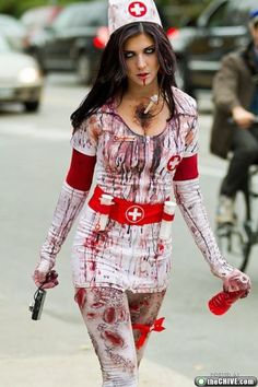 cool zombie. i like the water bottle of blood - cool prop. Instead of being a sexy nurse, the ladies can be this