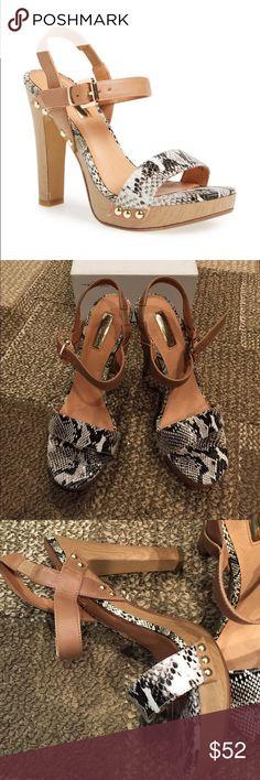 "Halogen Viv natural snake print platform sandals Stunning print adds a modern touch to the straps of a leather slingback sandals balanced with a tall wooden heel and platform. 5"" heel, 1"" platform. Fits size 8 and 8.5. Halogen Shoes Platforms"