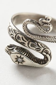 i'm a sucker for a good snake ring... Diamondback Ring - anthropologie.com