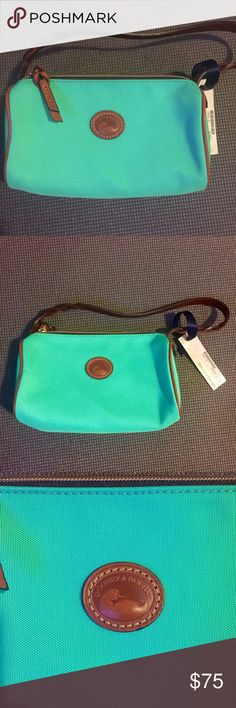 "Dooney & Bourke Small Barrel bag Mint NWT Dooney & Bourke small barrel handbag in mint. Style IN495 color MI. Approximately 4"" x 9"" x 3"". 100% authentic. Reasonable offers only please! Dooney & Bourke Bags Shoulder Bags"