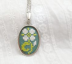 Hand embroidered necklace light flower on green  n050 by skrynka