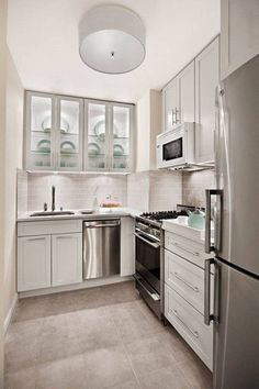Stainless Steel Dishwasher And White Cabinets Plus Cool Big Pendant Lamp In Beautiful L Shaped Kitchen Design For Small Space
