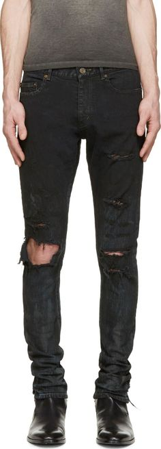 Skinny-fit jeans in black. Distressing and mottled coloring throughout. Five-pocket styling. Contrast stitching in muted yellow. Zip-fly.