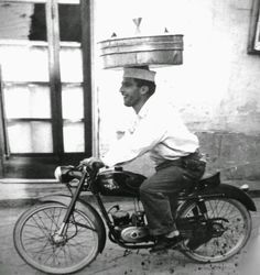 Pizza delivery, Naples, Italy, 1950s.