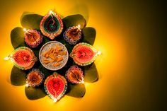 Clay Diya lamps lit during Dussehra with yellow flowers, green leaf and rice on yellow pastel background. Lulav And Etrog, Diya Lamp, Diwali Images, Flower Rangoli, Pastel Background, Indian Festivals, Happy Diwali, Presentation Templates, Yellow Flowers
