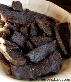 Cowgirl Beef (Oven Dried Peppered Beef Jerky) Oven-dried jerky recipe (go to the end of the article for the how-to) Jerky Recipes, Beef Recipes, Snack Recipes, Cooking Recipes, Snacks, Grill Recipes, Carne, Homemade Jerky, Good Food