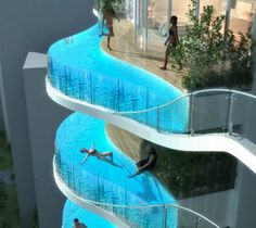 A 37-story residential skyscraper in Mumbai, India, called the Aquaria Grande Tower (currently under construction) will have the most awesome feature ever: glass swimming pools where the balconies normally go for some of the apartments