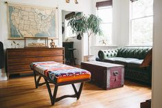 WELCOME TO HOMESTEAD 05 | US highway map, Pendleton Pearsall bench, green leather chesterfield, Mid Century lowboy dresser, red farmhouse trunk.