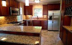 Shaker Heights OH KITCHEN REMODEL: Shaker Style Cabinets, Porcelain Tile Flooring, Stainless Steel Appliances, Granite Countertops, Travertine Brick Backsplash